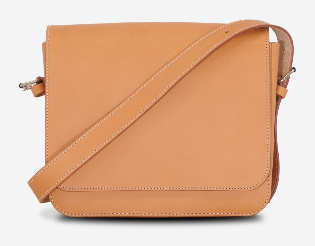 Front view of the small vegetable tanned leather crossbody bag for women.