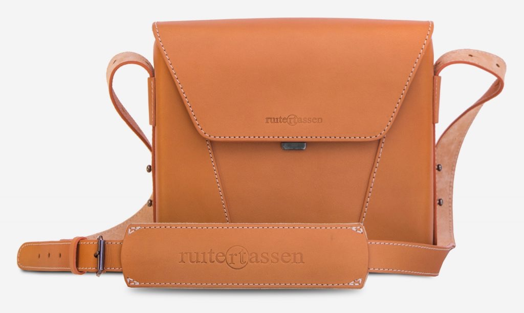 Front view of the small vegetable tanned leather crossbody bag.