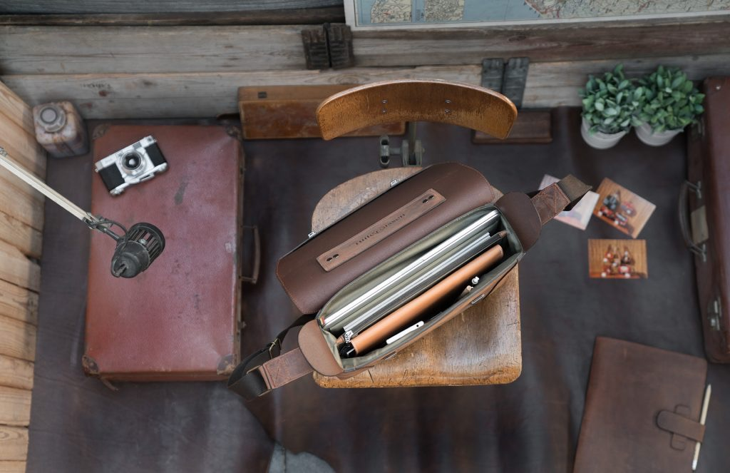 Trop view of the vegetable-tanned brown leather briefcase bag with laptop pocket.