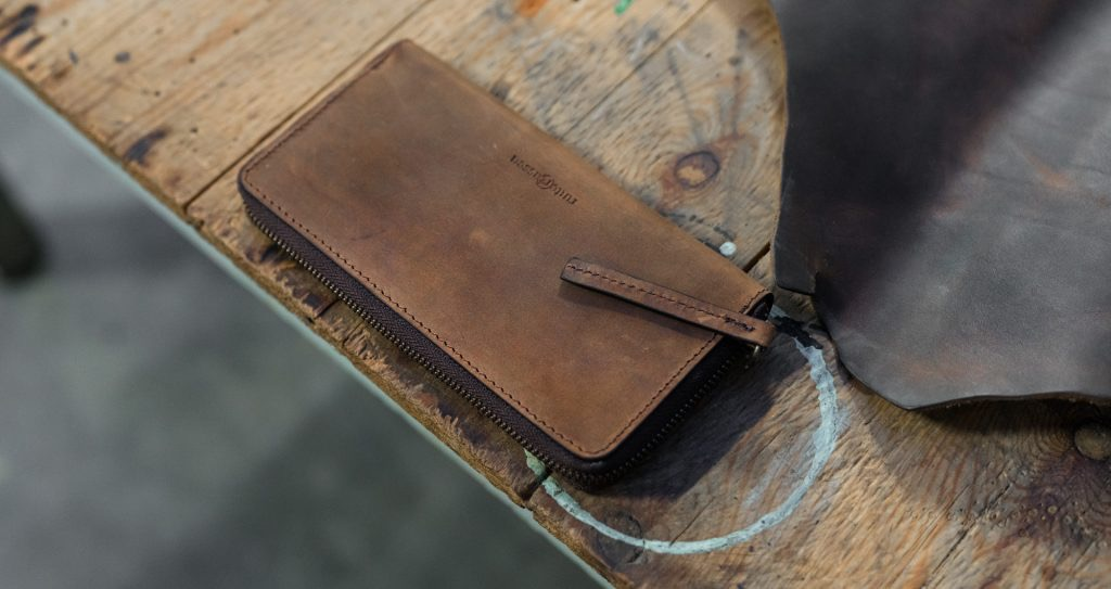 Top view of the long brown vegetable-tanned leather wallet.