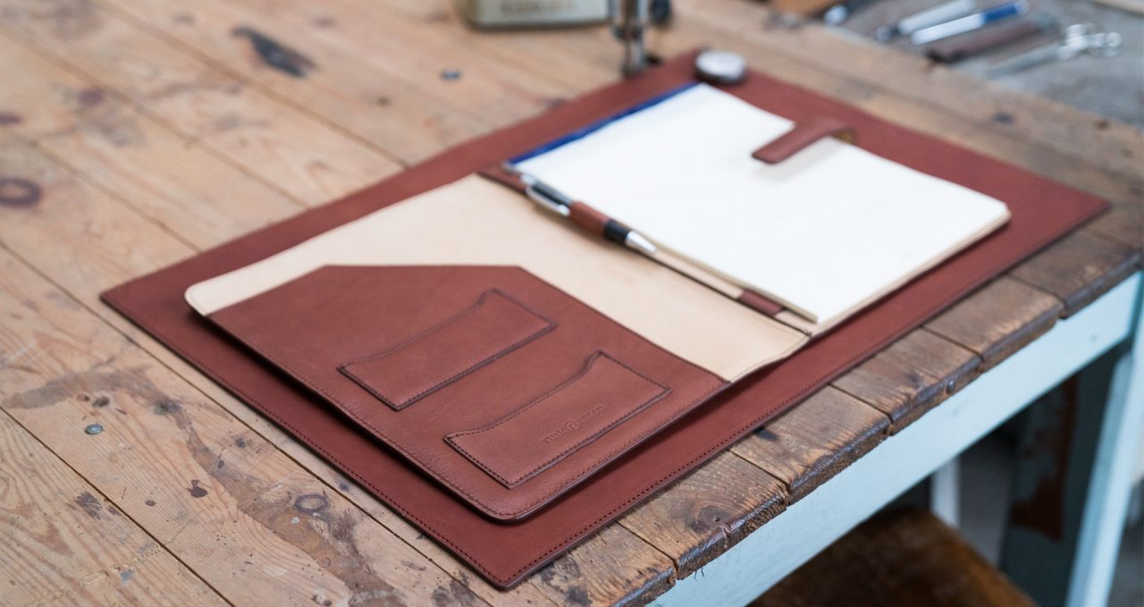Top view of the luxury vegetable tanned leather A4 folio.