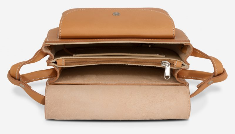 Inside view of the vegetable tanned leather shoulder bag for women with 2 compartments.