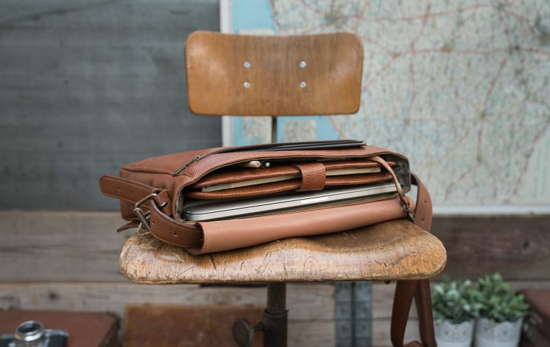 """Top view of the 13"""" soft leather messenger bag."""