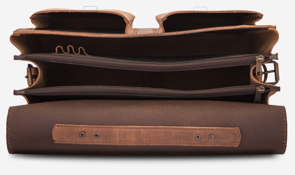 Inside view of large 3 compartments brown leather satchel with 2 front asymmetric pockets.