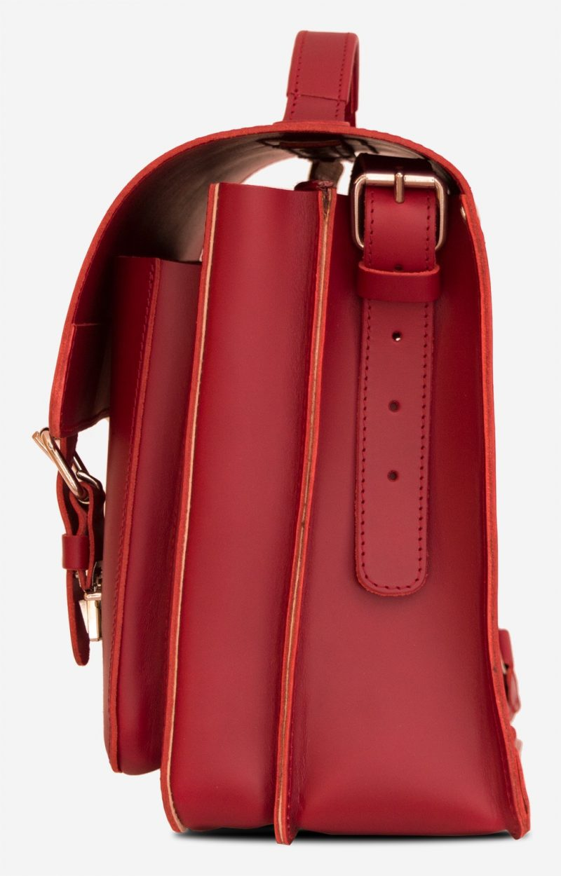 Side view of red leather satchel backpack with 2 gussets and asymmetric front pockets for women - 152237.