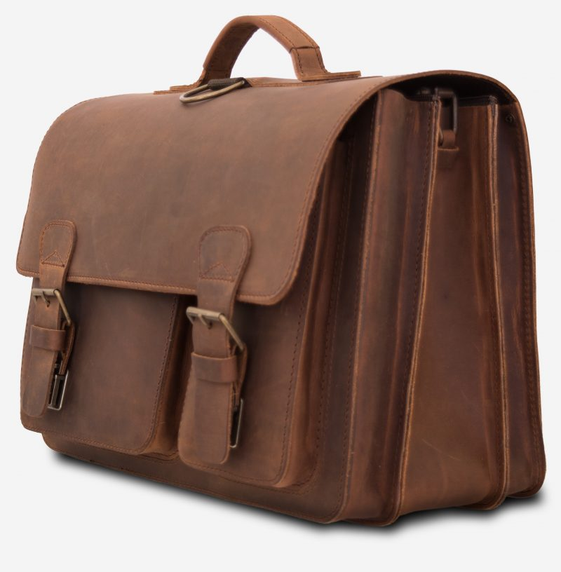 Large brown leather satchel briefcase with 3 compartments and 2 asymmetric front pockets.