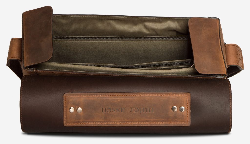 Inside view of the large vegetable-tanned brown leather briefcase bag with laptop pocket.