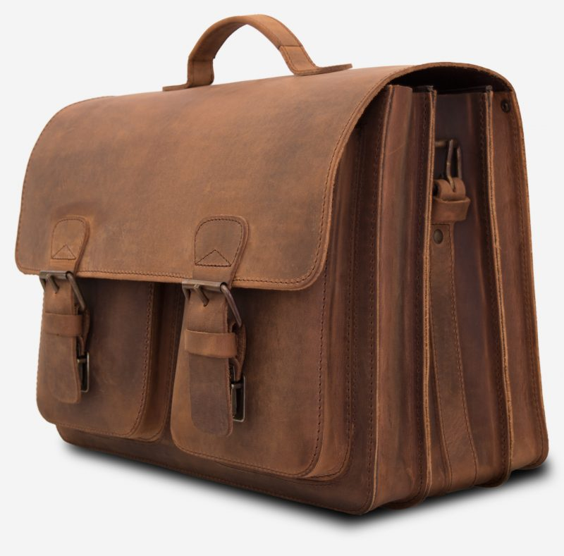 Side view of the large Professor brown leather satchel with 3 gussets and 2 symmetric front pockets.