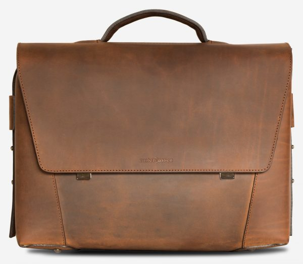Front view of the large vegetable-tanned brown leather briefcase bag with laptop pocket.
