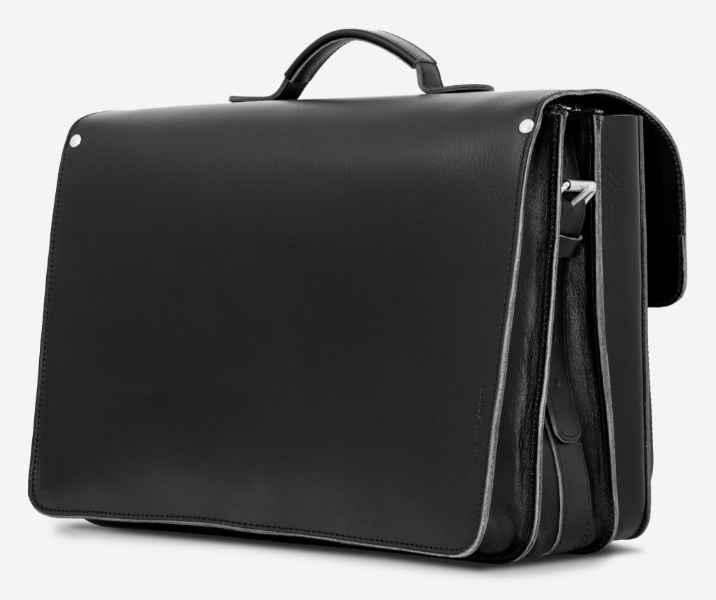 Back view of large black leather briefcase with 3 gussets and symmetric front pockets 112158.
