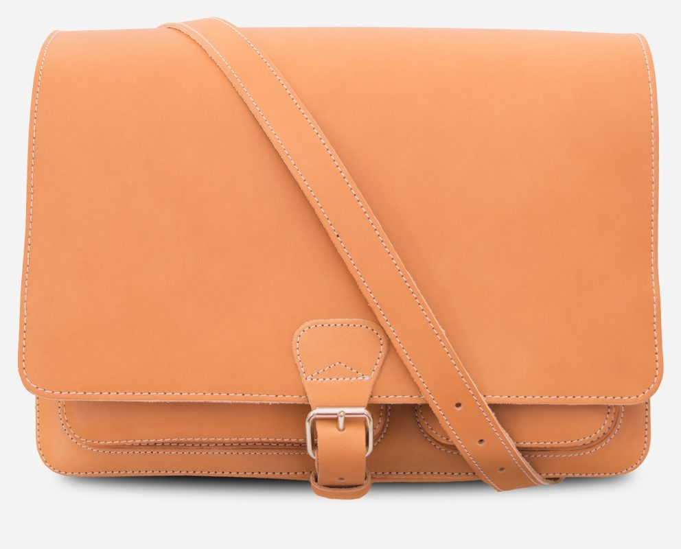 Front view of the large tan leather messenger bag with shoulder strap.