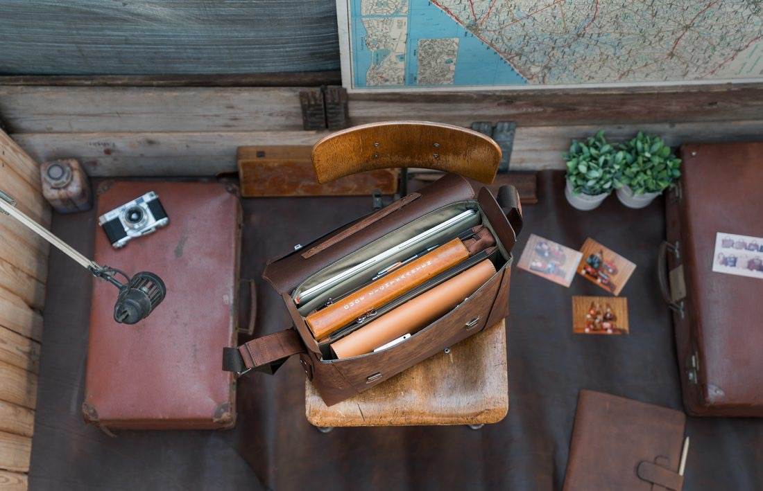 Top view of the large vegetable-tanned brown leather briefcase bag with laptop pocket.