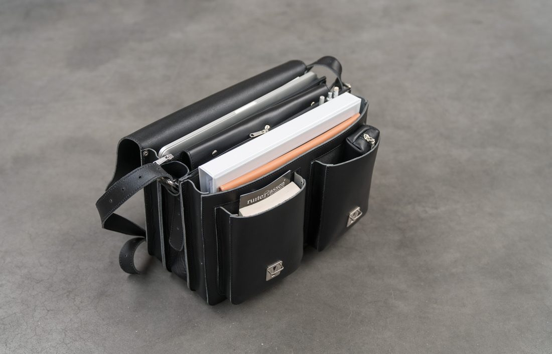 Open black leather satchel briefcase with 3 gussets and symmetric front pockets 112139.
