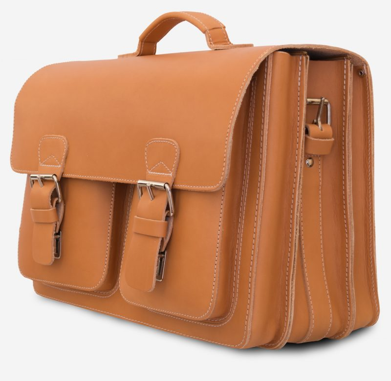 Side view of the large Professor tan leather satchel with 3 gussets and 2 symmetric front pockets.