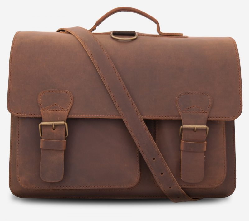 Front view of brown leather professor satchel with 2 compartments and 2 front pockets.