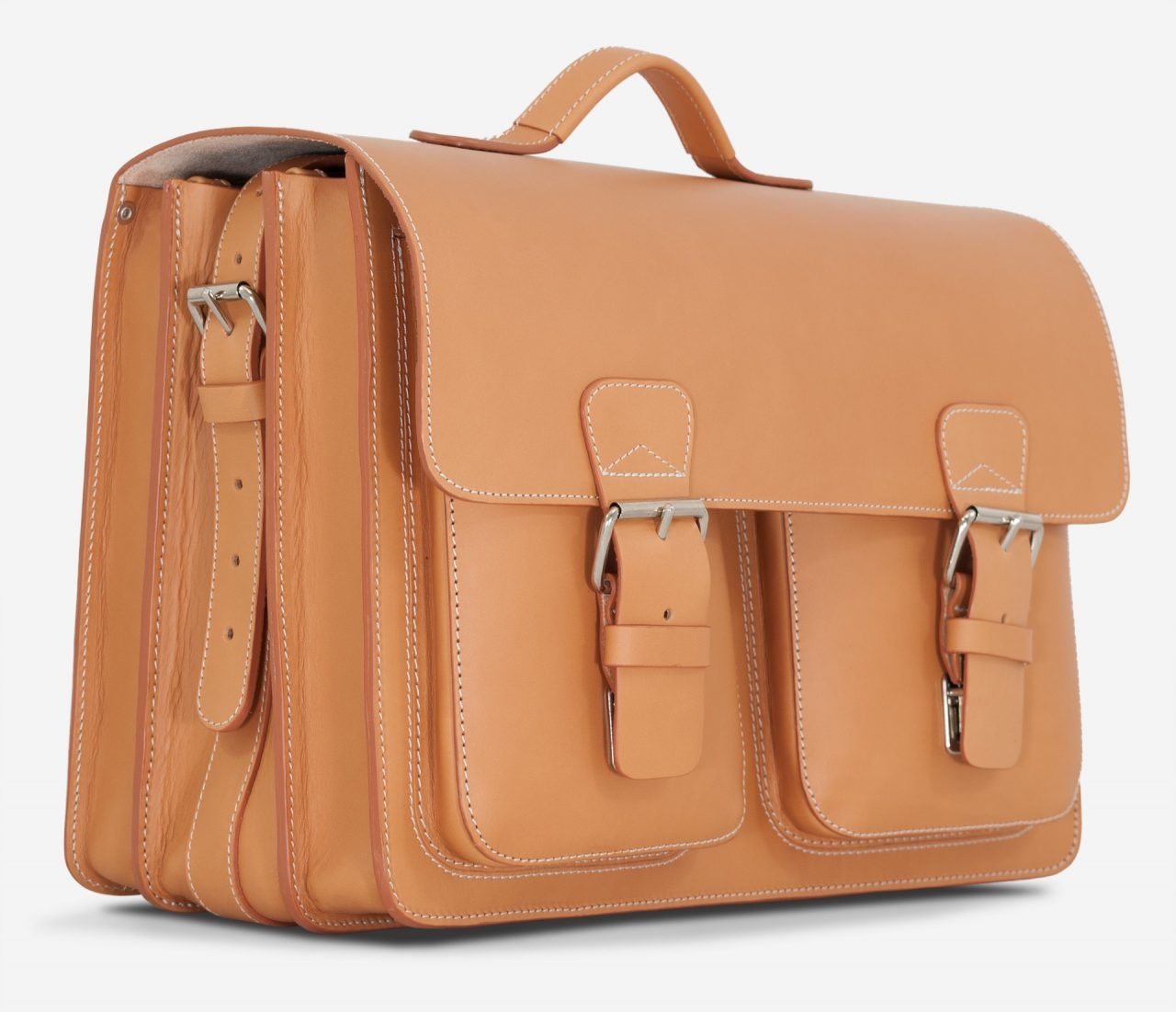 Side view of large Ruitertassen tan leather satchel with 3 gussets and 2 symmetric front pockets.
