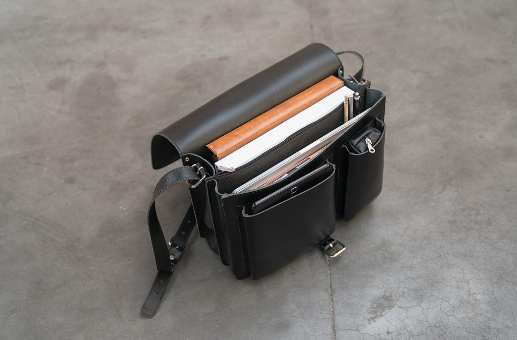 Open black leather messenger bag with 2 compartments and asymmetric front pockets - 112537.