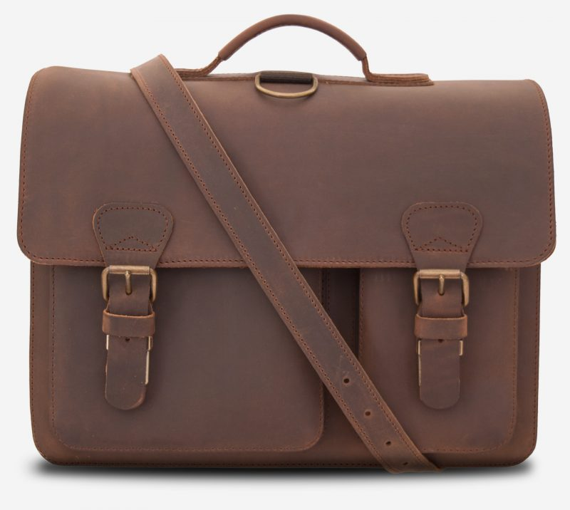 Front view of large brown leather satchel briefcase with a leather shoulder strap.