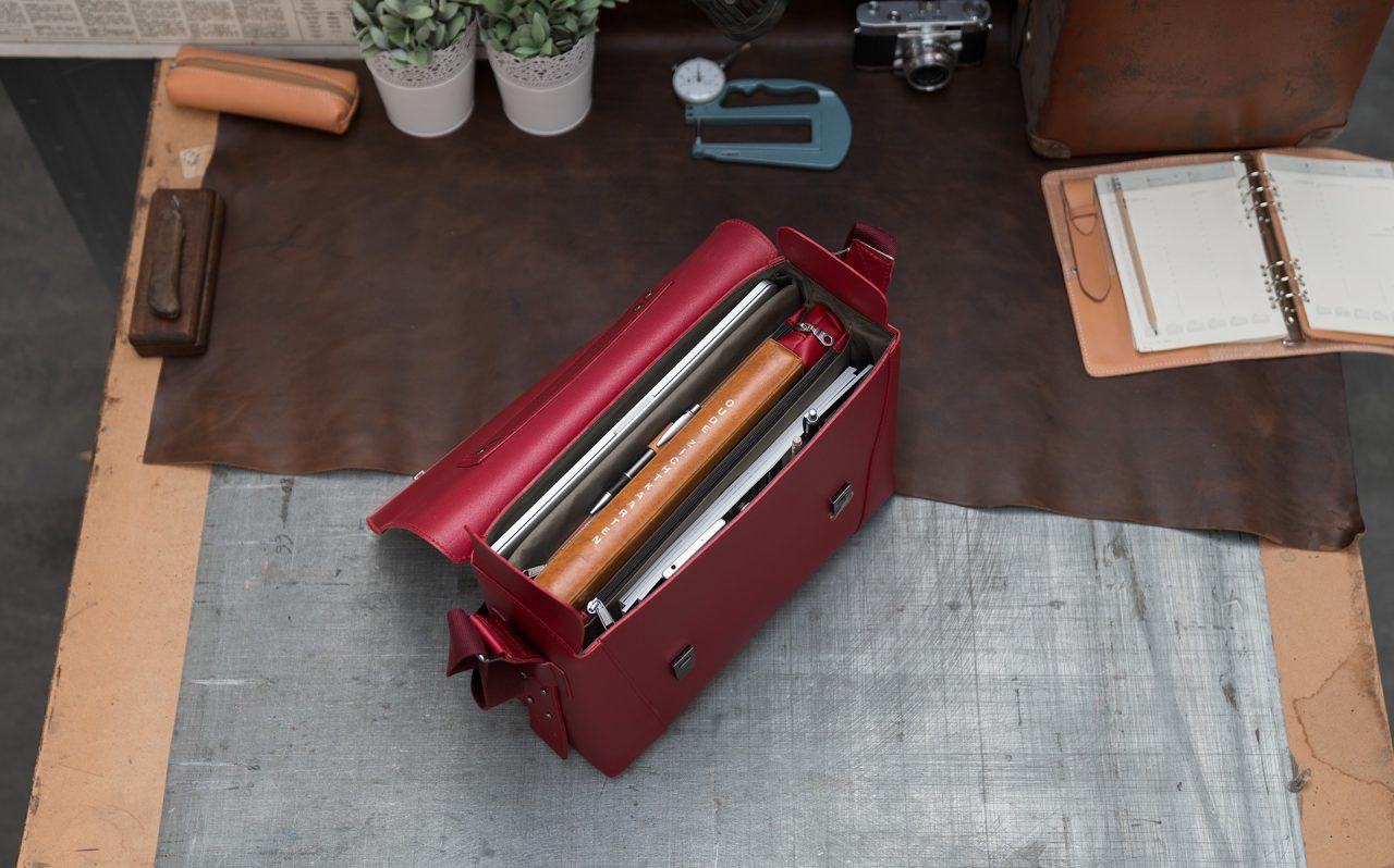 Top view of the large red vegetable-tanned leather briefcase bag with laptop pocket for women.