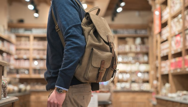 Man wearing the handmade soft leather backpack.