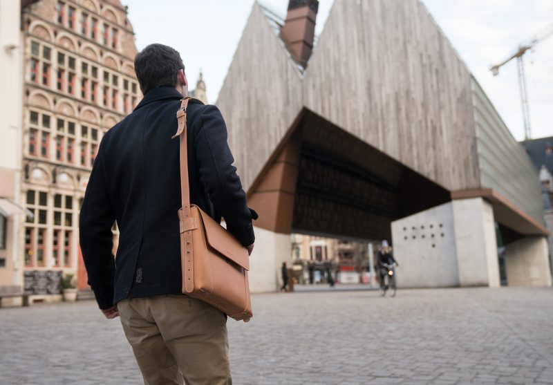 Man carrying on the shoulder the vegetable tanned leather slim briefcase bag - 102176.