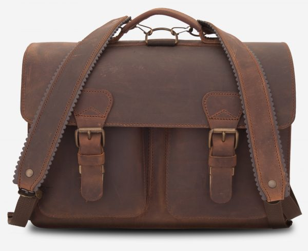 Front view of brown leather backpack satchel fitted with shoulder straps.