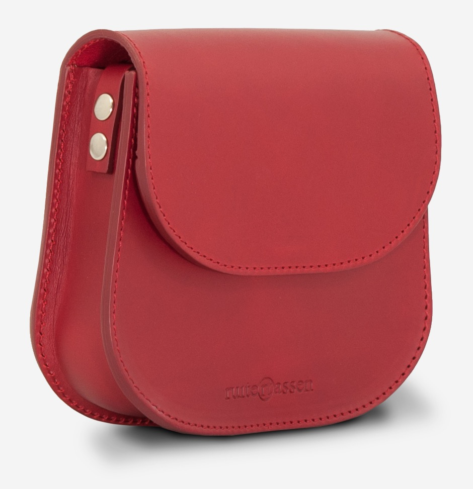 Side view of the small red full-grain leather shoulder bag for women.
