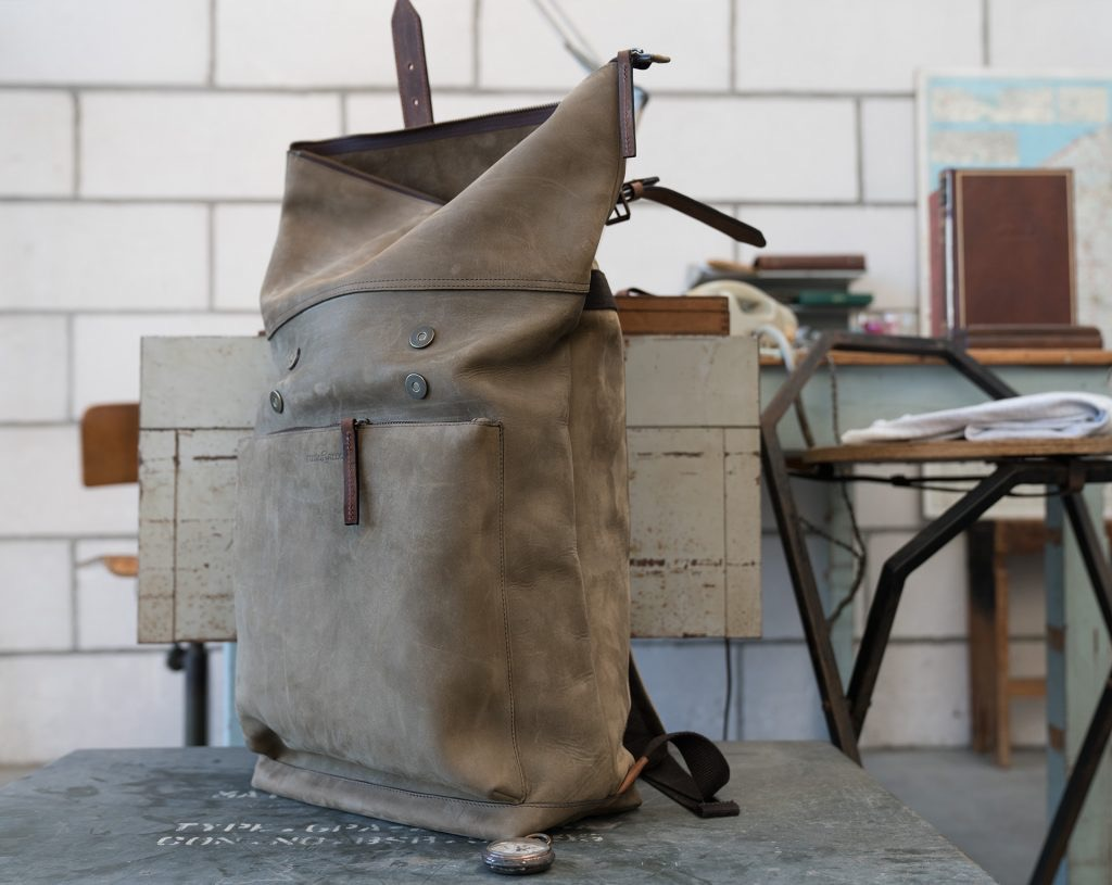 Rugged roll-top soft leather backpack.