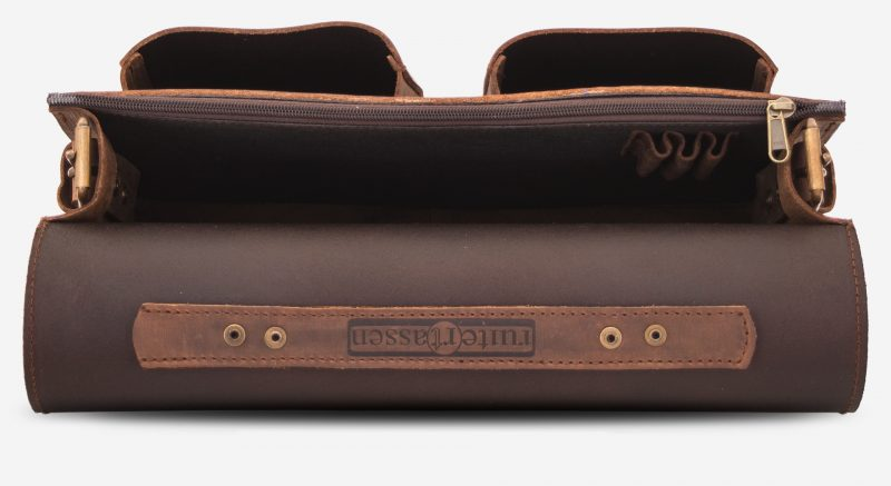 Inside view of the brown leather satchel briefcase with one main compartment and two front pockets.