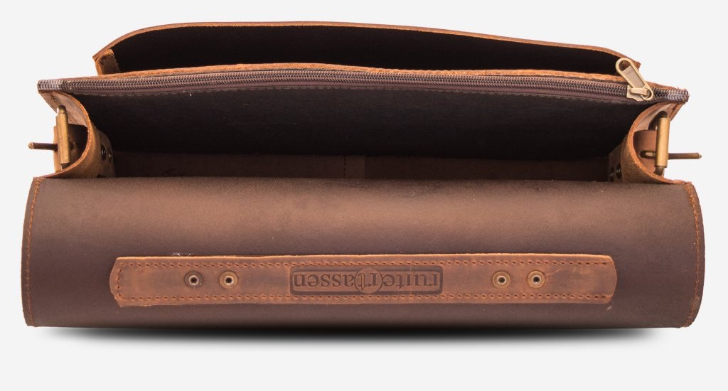 Inside view of the brown leather briefcase with one main compartment and one front pocket.