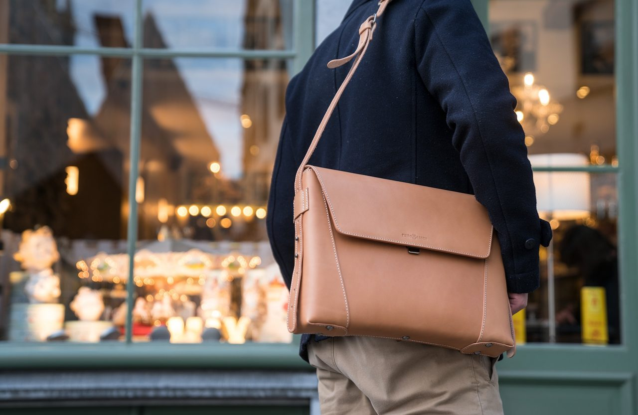Man carrying the vegetable tanned leather slim briefcase bag - 102176.