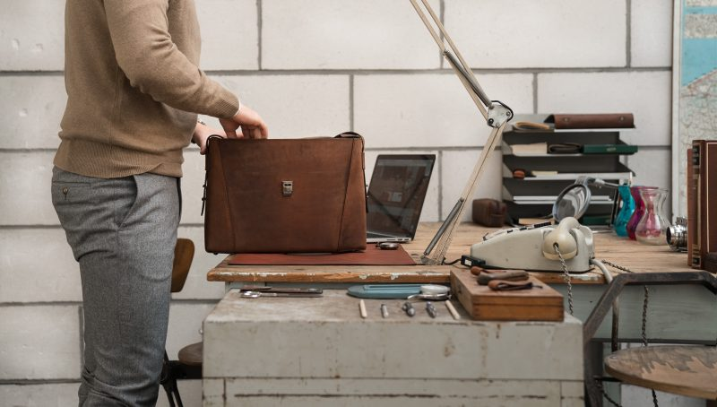 Man looking into his slim vegetable-tanned brown leather briefcase bag.