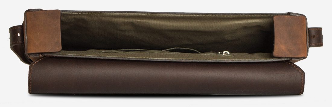 Inside view of the slim vegetable-tanned brown leather briefcase bag.