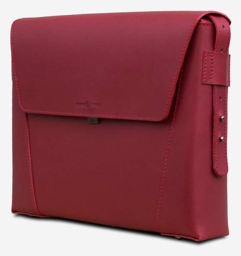 Side view of the slim red vegetable-tanned leather briefcase bag.