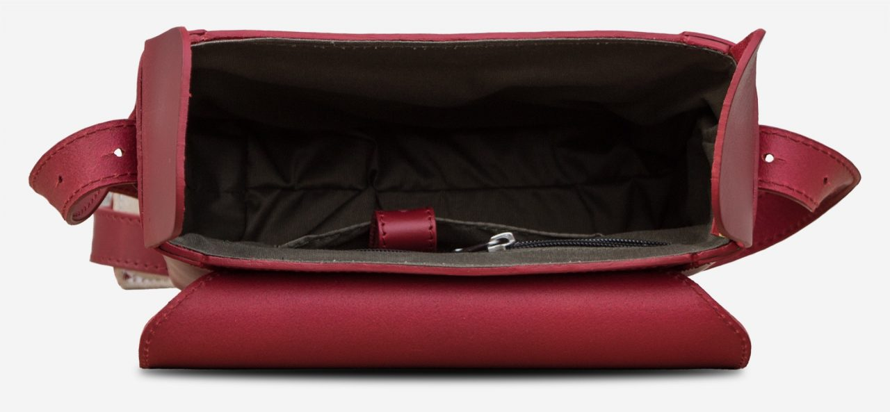 Inside view of the small red vegetable-tanned leather crossbody bag for women.