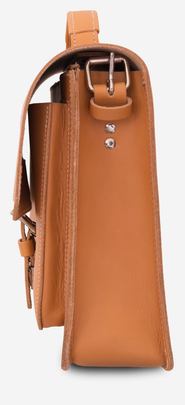 Side view of the tan leather briefcase with a single compartment and a front pocket.