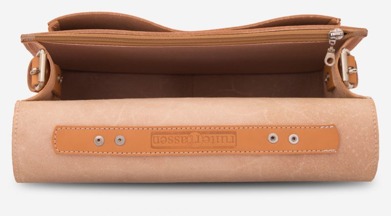 Inside view of the tan leather briefcase with one main compartment and one front pocket.