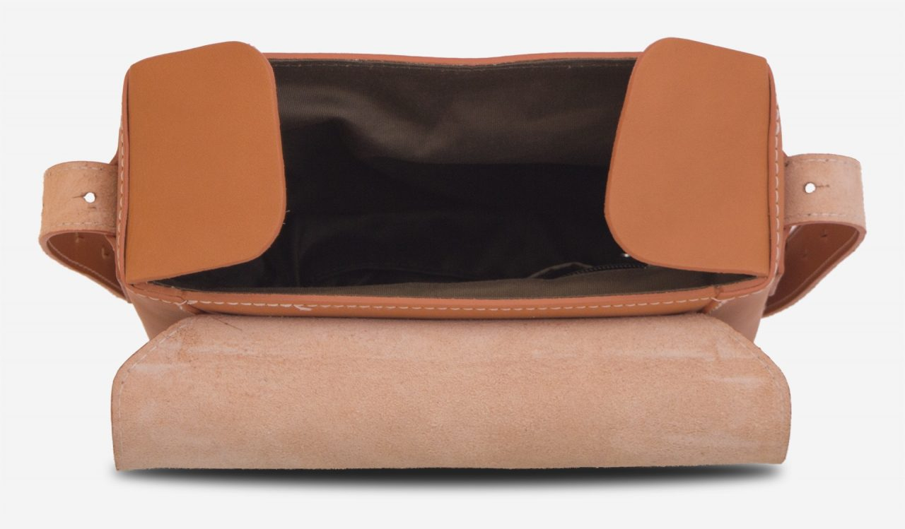 Inside view of the small vegetable tanned leather crossbody bag.