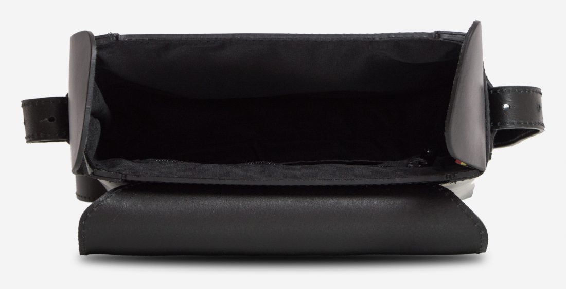 Inside view of the small black vegetable-tanned leather crossbody bag.