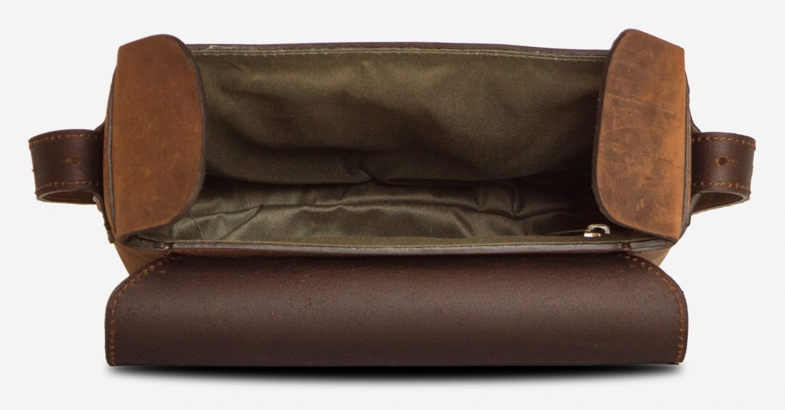 Inside view of the small vegetable-tanned brown leather crossbody bag for men.