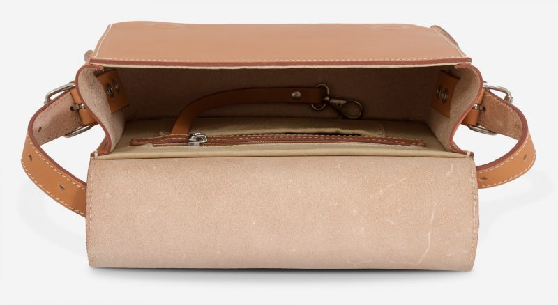 Inside the small vegetable tanned leather crossbody bag for women.
