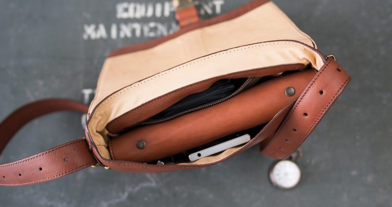 Top view of the luxury soft vegetable-tanned brown leather crossbody bag for men.