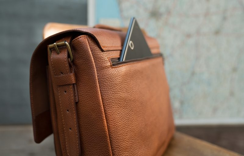 "Back view of the 13"" soft leather satchel briefcase with tablet in back pocket."