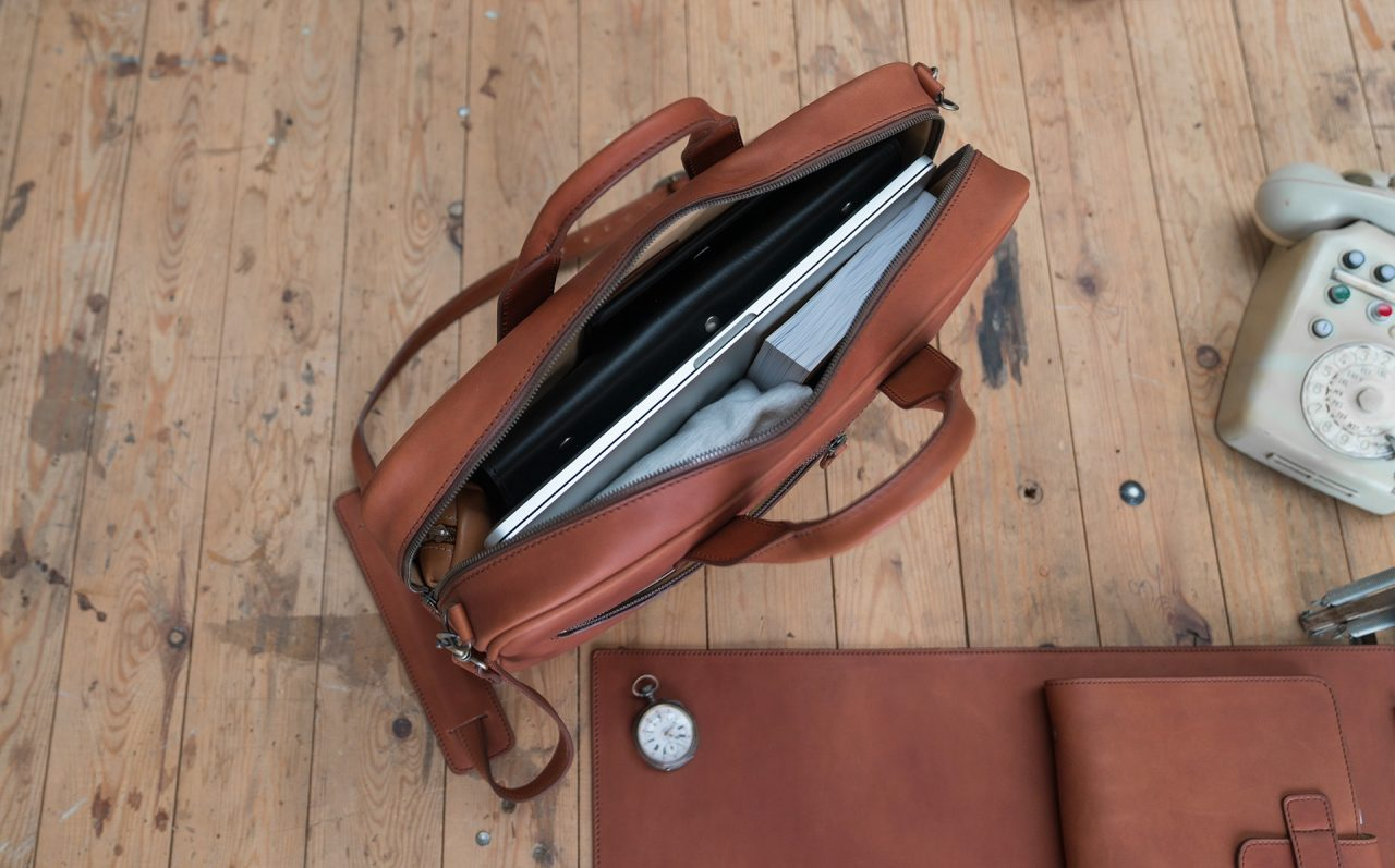 Top view of the luxury brown vegetable-tanned leather briefcase for men.