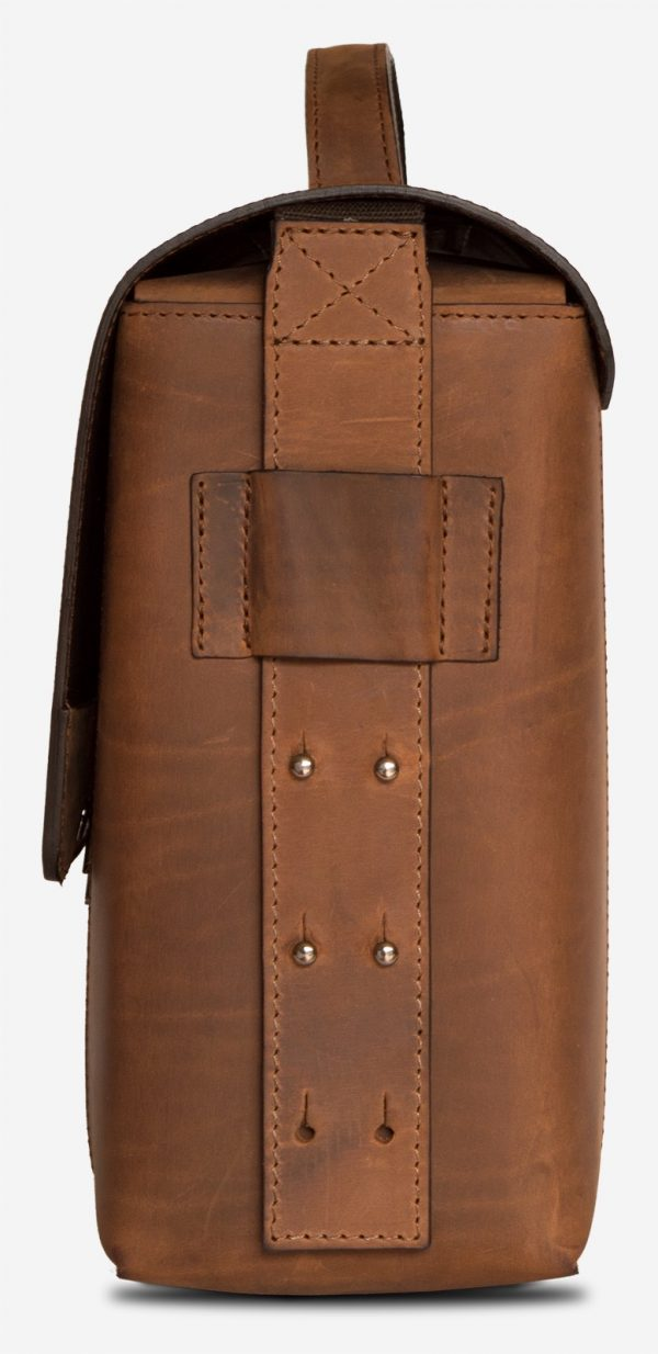 Side view of the large vegetable-tanned brown leather briefcase bag.