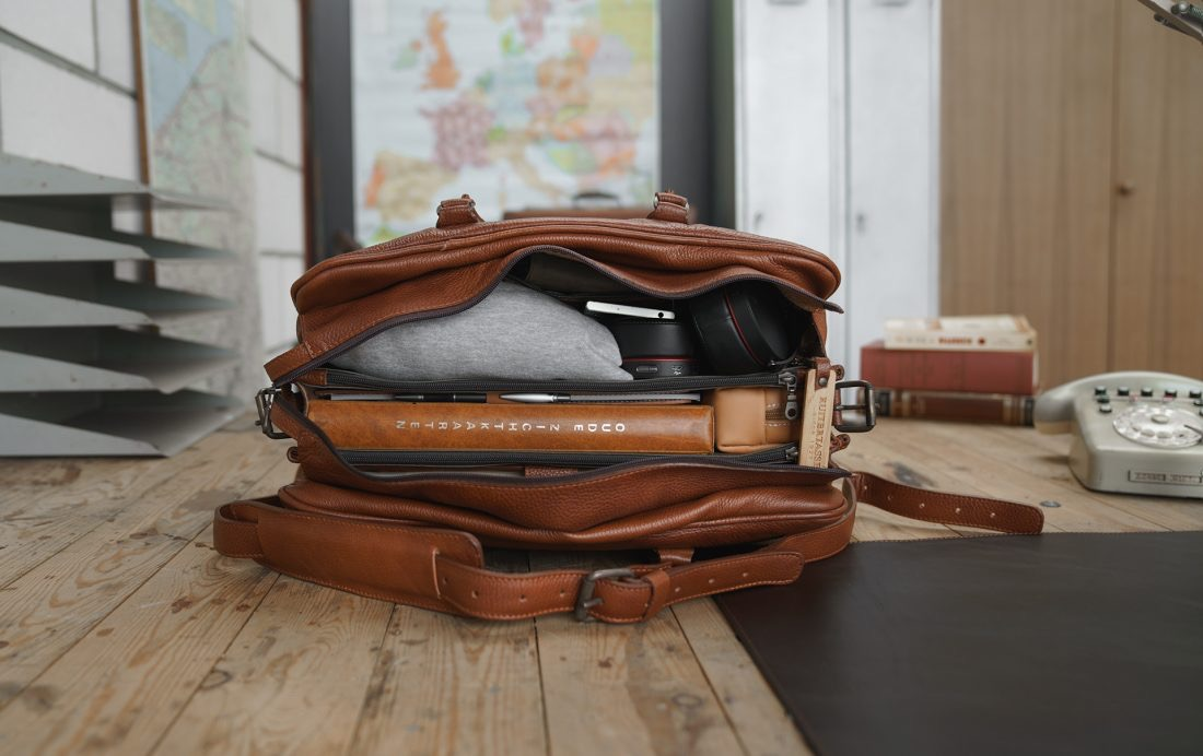 """Top view of the 17"""" brown soft leather travel bag."""