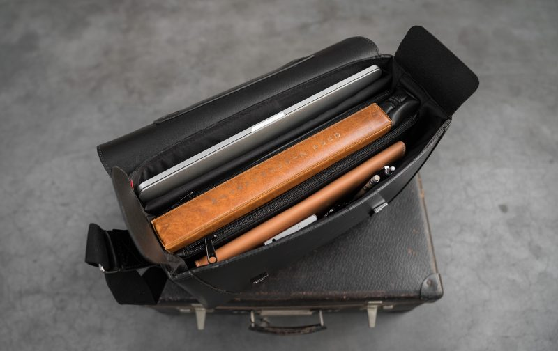 Top view of the large black vegetable-tanned leather briefcase bag with laptop pocket.