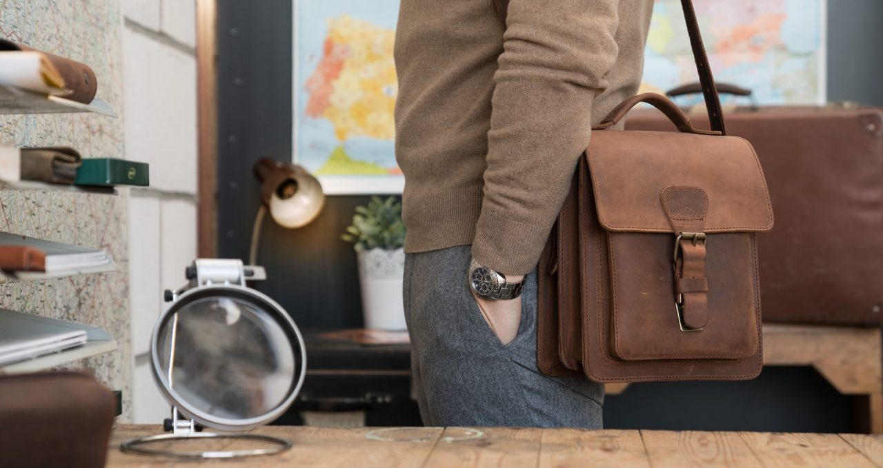 Man wearing the handmade vegetable-tanned brown leather crossbody bag.