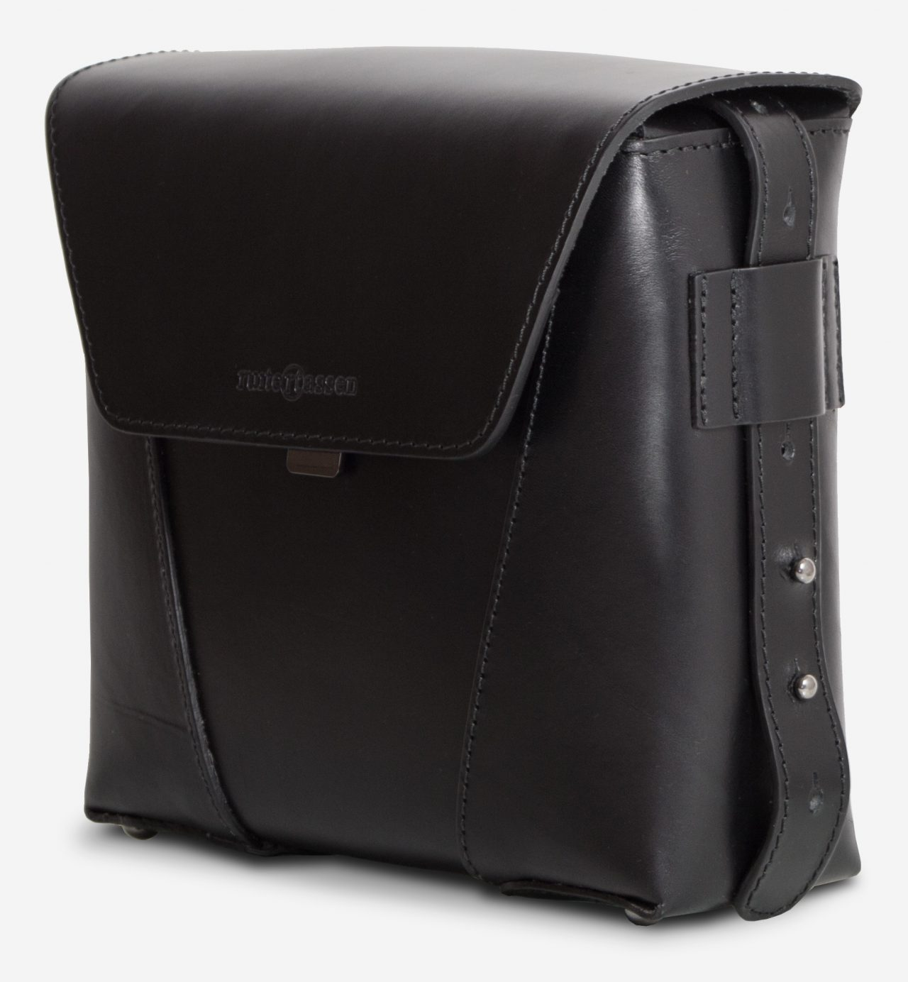 Side view of the small black vegetable-tanned leather crossbody bag.