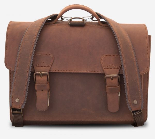 Front view of tan leather backpack satchel fitted with shoulder straps.